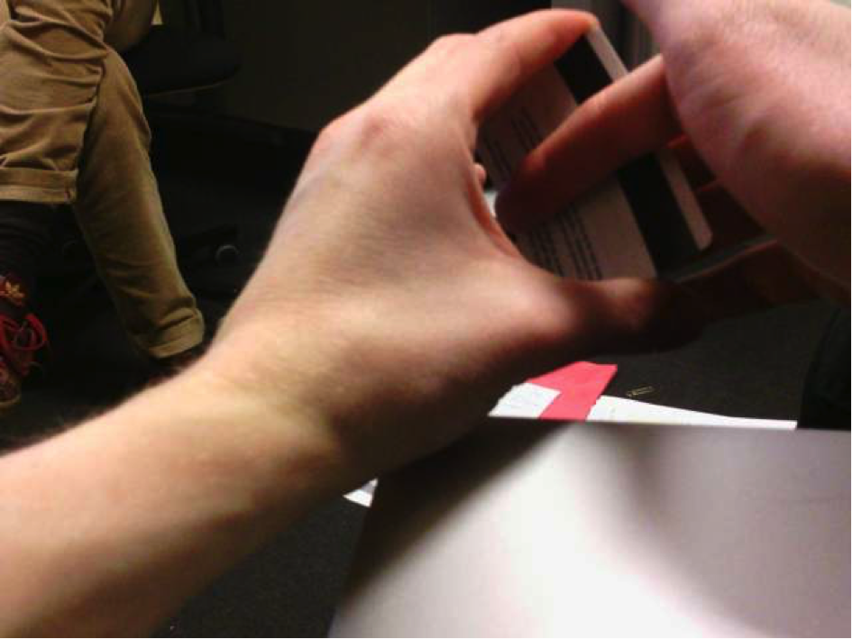 Figure 10. Due to the camera being located at chest level, the lifelog reveals a number of habitual hand gestures such as flipping a card during conversation.