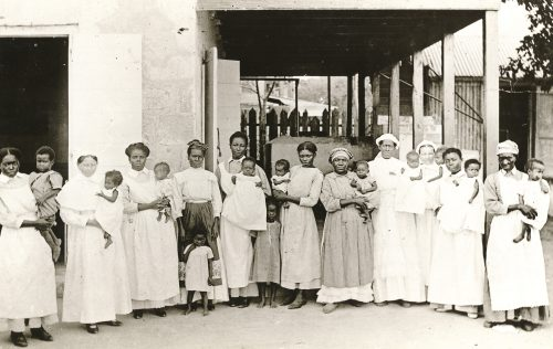 Photograph from Deaconess orphanage, Frederiksted, St. Croix. Group photo including Sister Maren, Miss James, Marchal and Sister Nic. Maritime Museum of Denmark.